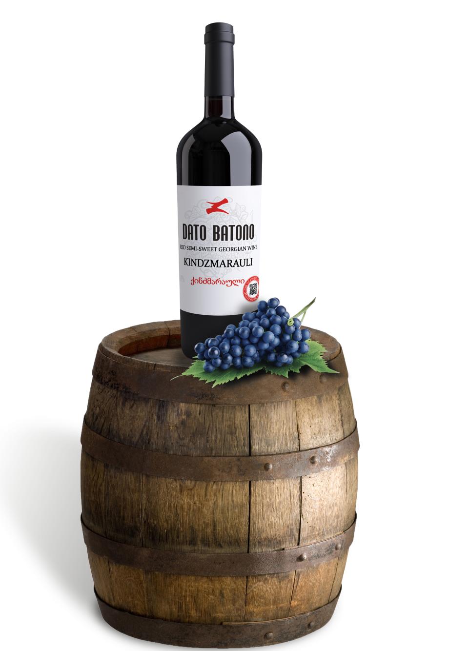 Wine bottle standing on barrel